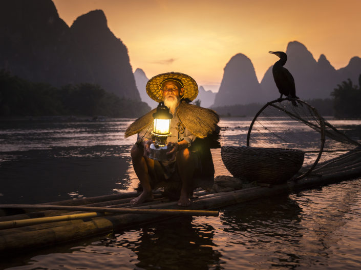 pescador-cormoran-xingping-china-phototravel